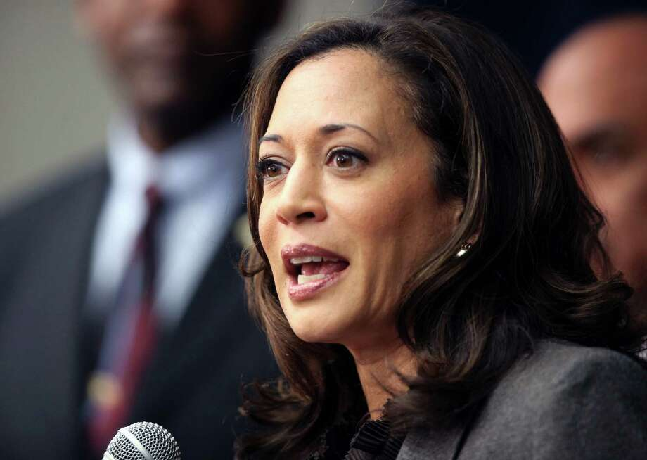 """FILE - This Nov. 16,2012 file photo shows California Attorney General Kamala Harris speaking during a news conference in Los Angeles. President Barack Obama praised Harris for more than her smarts and toughness at a Democratic Party event Thursday, April 4, 2013. The president also commended  Harris for being """"the best-looking attorney general"""" during a Democratic fundraising lunch in the Silicon Valley.(AP Photo/Richard Vogel,File) Photo: Richard Vogel"""