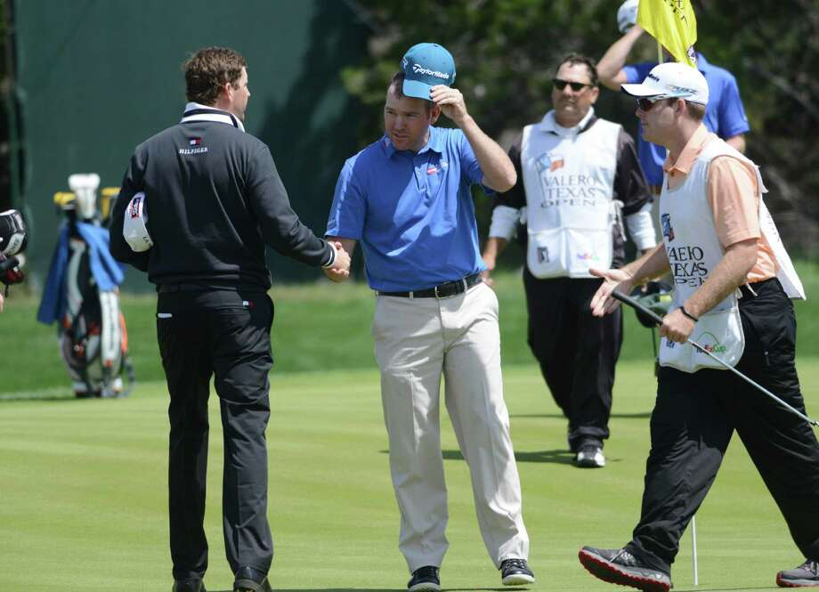 D.J. Trahan, left, and Troy Matteson shake hands after their second-round finishes a the Valero Texas Open at TPC San Antonio's AT&T Oaks Course on Friday, April 5, 2013. Photo: Billy Calzada, San Antonio Express-News / San Antonio Express-News