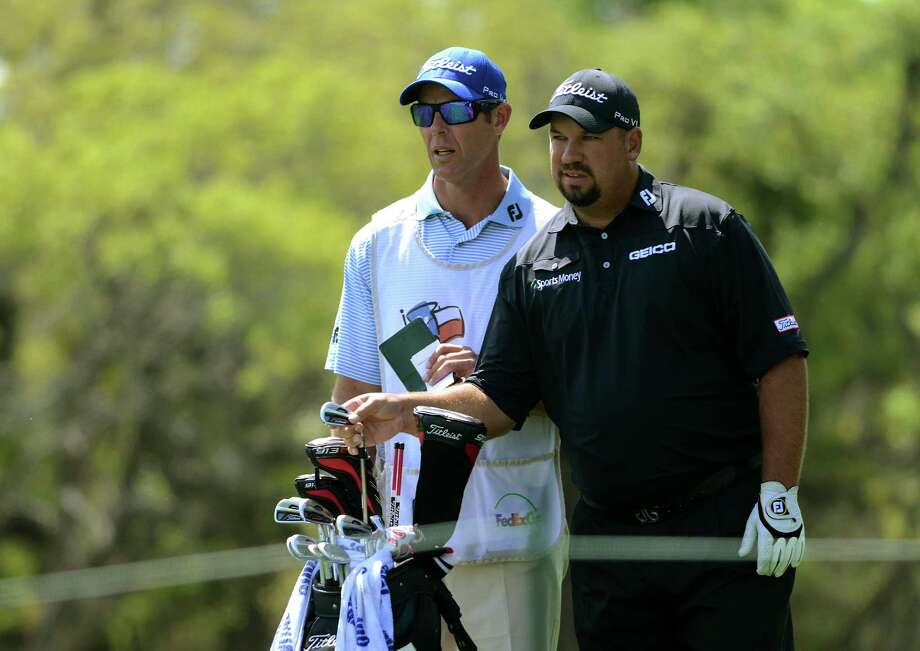 Brendeon de Jonge and his caddy look over an upcoming shot during the second round of the Valero Texas Open at TPC San Antonio's AT&T Oaks Course on Friday, April 5, 2013. Photo: Billy Calzada, San Antonio Express-News / San Antonio Express-News