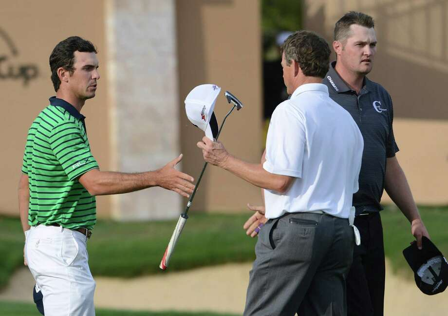 Billy Horschel, left, greets fellow golfers Lee Janzen and Jason Kokrak after finishing at 8 under par after the second round of the Valero Texas Open at TPC San Antonio's AT&T Oaks Course on Friday, April 5, 2013. Photo: Billy Calzada, San Antonio Express-News / San Antonio Express-News