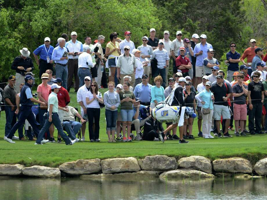 Fans watch as golfers prepare to play during the second round of the Valero Texas Open at TPC San Antonio's AT&T Oaks Course on Friday, April 5, 2013. Photo: Billy Calzada, San Antonio Express-News / San Antonio Express-News
