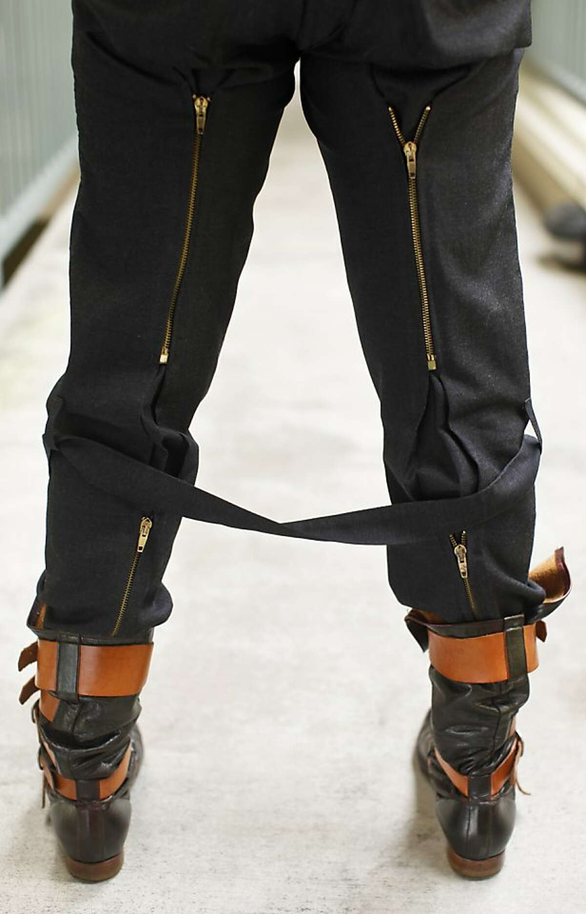 Fashion designer and punk rock musician Keanan Duffty wears his Vivienne Westwood bondage pants on Monday, March 18, 2013 in San Francisco, Calif.