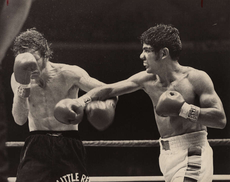 Mike Ayala's right hand lets heavily favored Danny 'Little Red' Lopez know he's in for a fight in their June 17, 1979 world title bout. The oldest of four fighting sons of Tony Ayala Sr., San Antonio's first - and most notorious - family of boxing. CREDITT: EXPRESS-NEWS FILE PHOTO Photo: STEVE CAMPBELL, SAN ANTONIO EXPRESS-NEWS / EXPRESS-NEWS FILE PHOTO