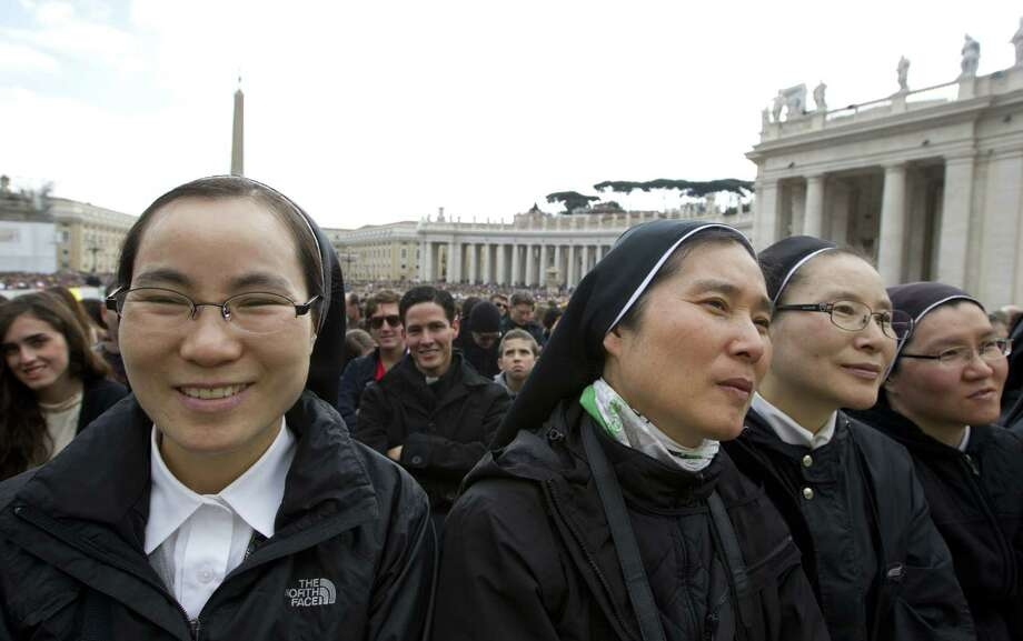 A group of nuns attend Pope Francis' weekly general audience in St. Peter square at the Vatican on Wednesday. The pope's remarks portrayed a greater, but not a major, openness to women's importance in the faith. Photo: Alessandra Tarantino / Associated Press