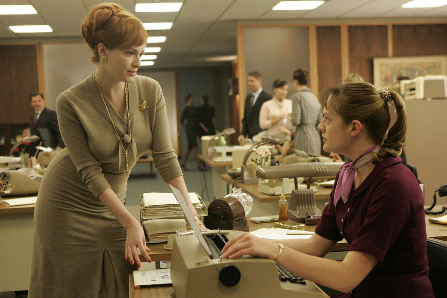 Joan Holloway (Christina Hendricks) and Peggy Olson (Elisabeth Moss) are secretaries at the Sterling Cooper Advertising Agency.