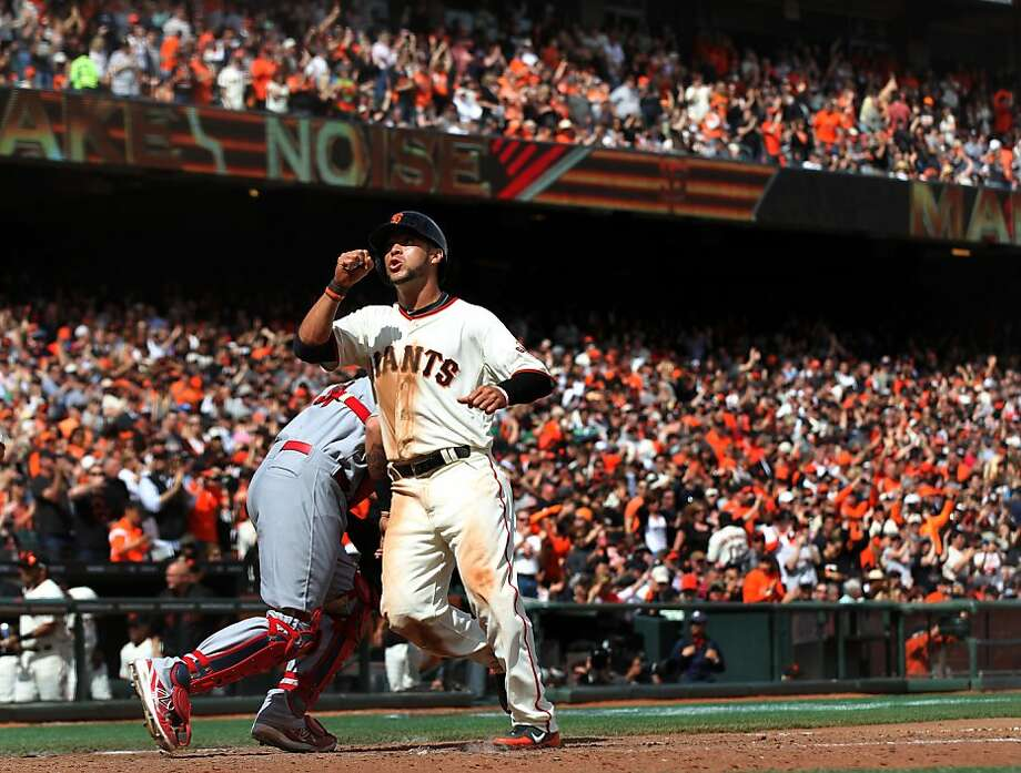 Gregor Blanco thanks the gods - and rightfully so - after scoring on Angel Pagan's bases-loaded walk. Photo: Lance Iversen, The Chronicle