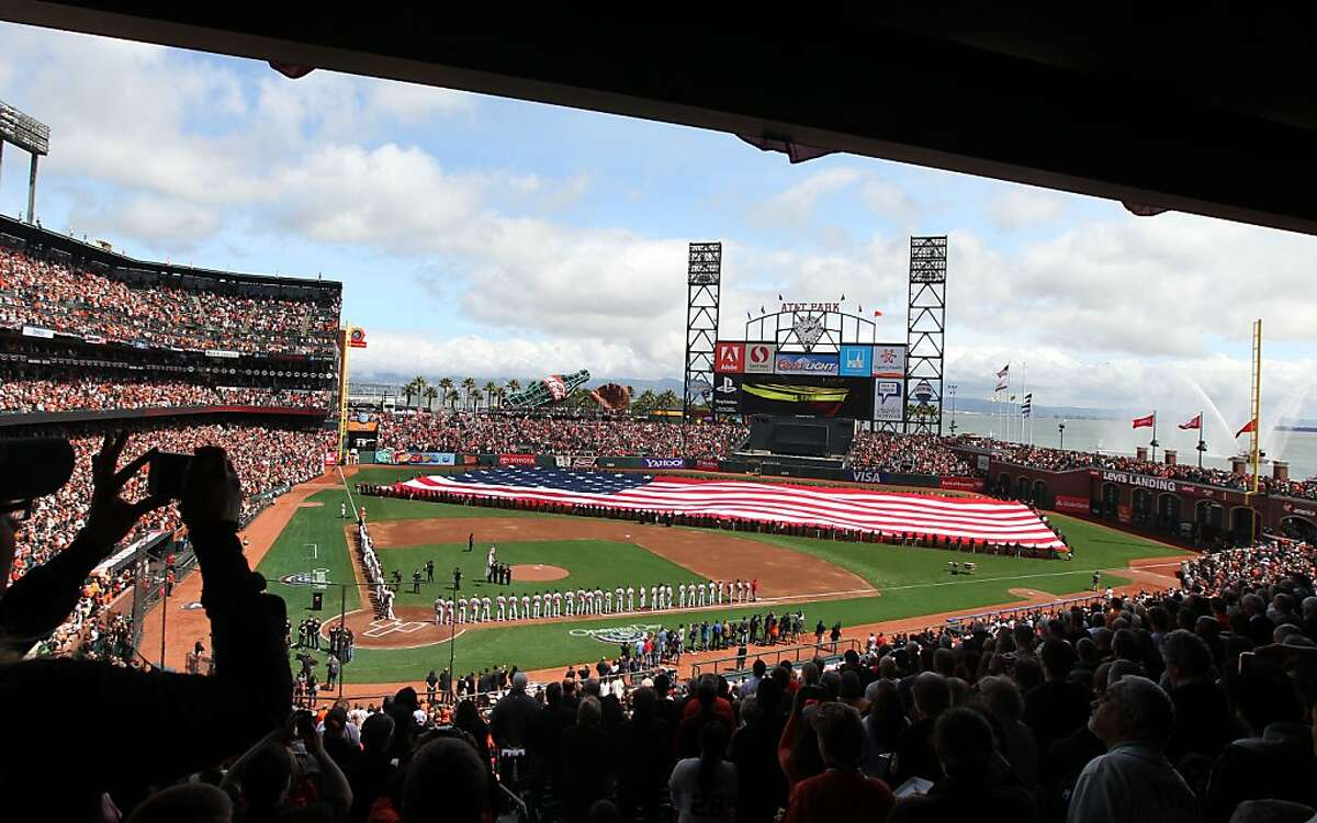 Opening day 2013 at AT&T Park featured an unfurling of a giant Stars and Stripes.