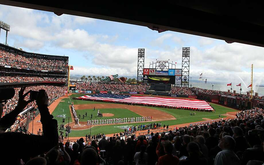 Opening Day 2013 featured an unfurling of a giant Stars and Stripes. Photo: Lance Iversen, The Chronicle