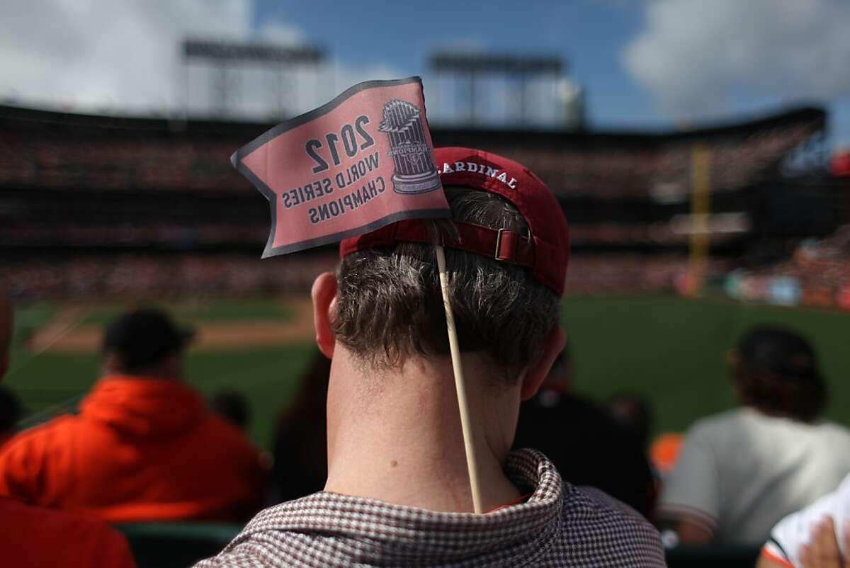 Joe Osekowsky wears a flag in his hat at AT&T park during the Giants season opener against the Cardinals on April 5th 2013.