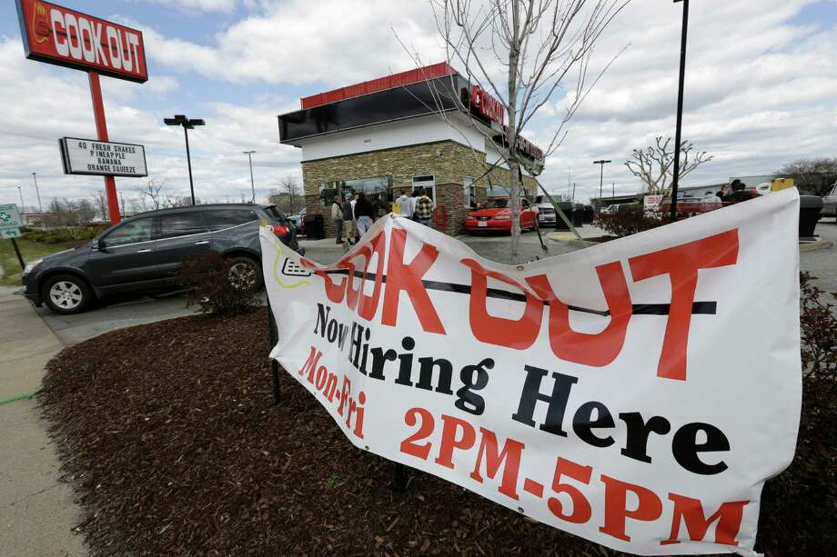 This  Friday, March 29, 2013, photo, shows a help wanted sign in front of a restaurant in Richmond, Va.  The U.S. economy has enjoyed a four-month stretch of robust job gains, and on Friday, April 5, 2013, the government will signal whether that trend endured into March  (AP Photo/Steve Helber) Photo: Steve Helber