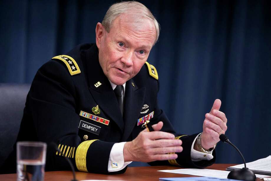 FILE - In this March 28, 2013 file photo, Joint Chiefs Chairman Gen. Martin Dempsey gestures while speaking during a news conference at the Pentagon. The top U.S. military official says North Korea's bellicose rhetoric, including threats to attack the United States, follows its decades-long pattern of provocation followed by non-violent accommodation. Dempsey said Friday the situation is worrisome, given the stakes. But he suggested that it does not appear to point toward war.  (AP Photo/Jacquelyn Martin, File) Photo: Jacquelyn Martin