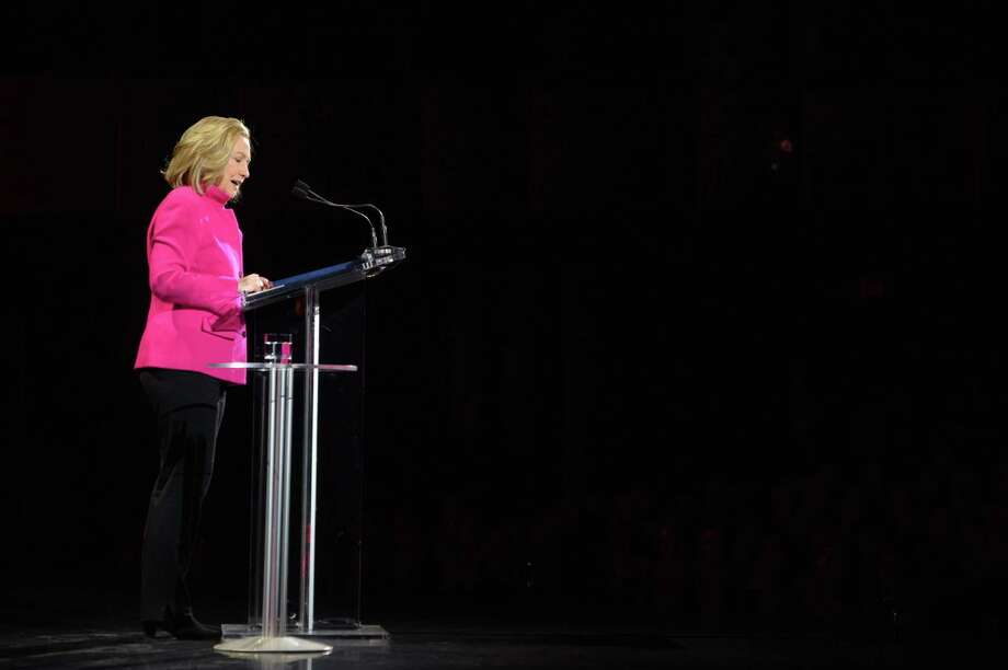 """This image released by Women in the World shows former Secretary of State Hillary Rodham Clinton  speaking at the Women in the World Conference on Friday, April 5, 2013 in New York. Clinton said Friday that the rights of women represent """"the unfinished business of the 21st century"""" in the United States and around the world, receiving a rapturous reception for one of her first speeches since departing the Obama administration.  (AP Photo/Women in the World, Marc Bryan-Brown) Photo: Marc Bryan-Brown"""