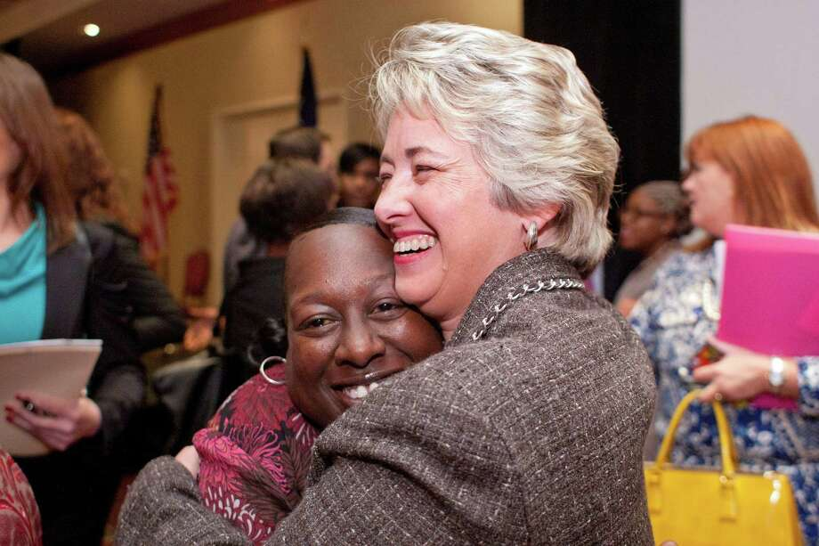 Mayor Annise Parker's speech at the Coalition for the Homeless event Friday drew a hug from the Houston Housing Authority's Phillis Wilson. Photo: Johnny Hanson, Staff / © 2013  Houston Chronicle