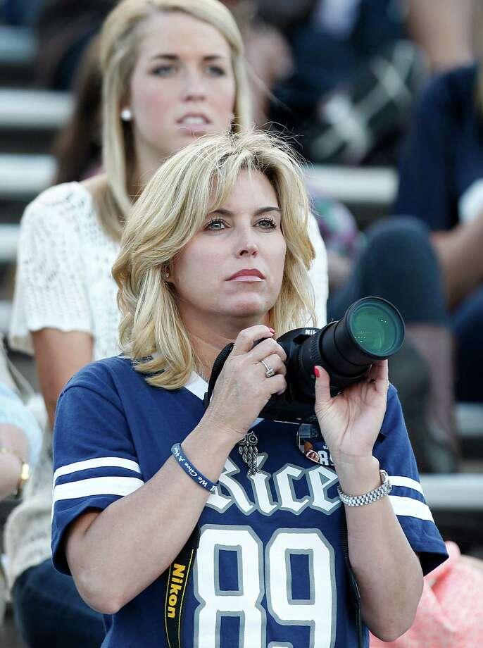 A Rice fan takes photos of the 2013 spring football game. Photo: Thomas B. Shea, For The Chronicle / © 2013 Thomas B. Shea