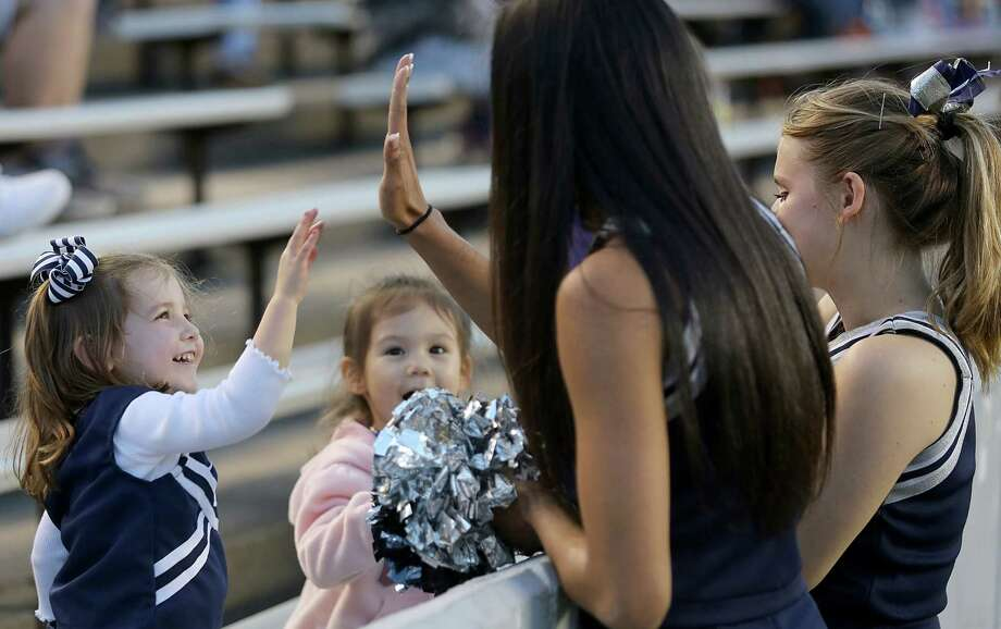 A young Rice fan greets an Owls cheerleader. Photo: Thomas B. Shea, For The Chronicle / © 2013 Thomas B. Shea