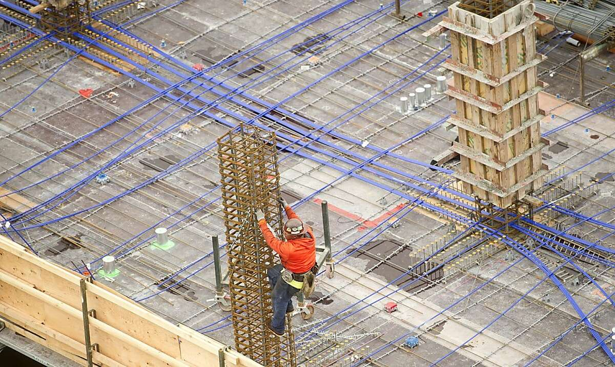 A worker prepares a support column at an apartment complex at 5th and Folsom Streets in San Francisco on Thursday, April 4, 2013.