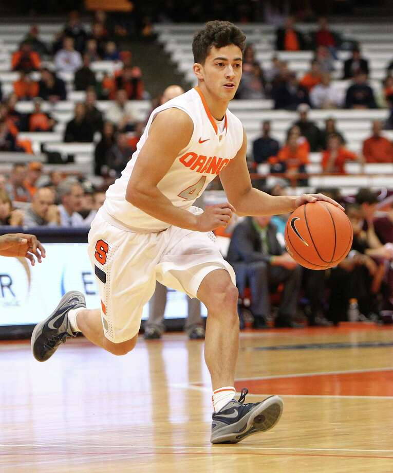 SYRACUSE, NY - NOVEMBER 04: Nolan Hart #4 of the Syracuse Orange takes the ball down the court during the game against the Bloomsburg Huskies at the Carrier Dome on November 4, 2012 in Syracuse, New York. (Photo by Nate Shron/Getty Images) Photo: Nate Shron / 2012 Nate Shron
