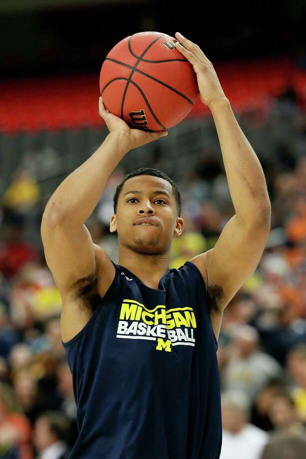 ATLANTA, GA - APRIL 05:  Trey Burke #3 of the Michigan Wolverines shoots during practice prior to the NCAA Men's Final Four at the Georgia Dome on April 5, 2013 in Atlanta, Georgia.  (Photo by Kevin C. Cox/Getty Images) Photo: Kevin C. Cox