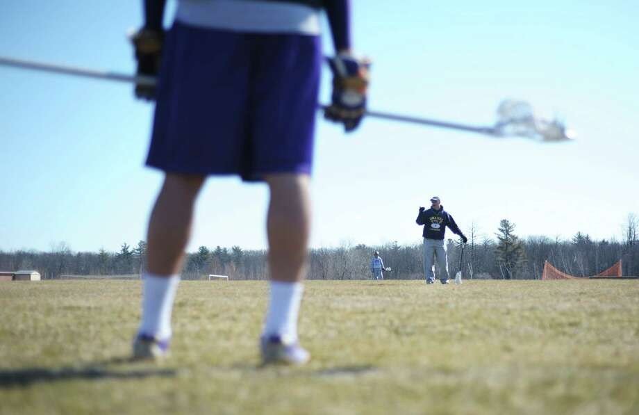 Head coach Tim Vivian gives directions to his players as they worked on clearing the ball during  CBA boys' lacrosse practice on Thursday, April 4, 2013 in Colonie, NY.   (Paul Buckowski / Times Union) Photo: Paul Buckowski