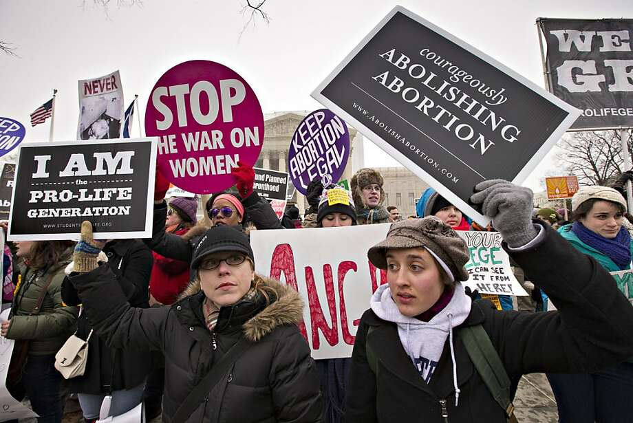 Anti-abortion activists and supporters of legal abortion in front of the Supreme Court, Friday, Jan. 25, 2013 Photo: J. Scott Applewhite, Associated Press