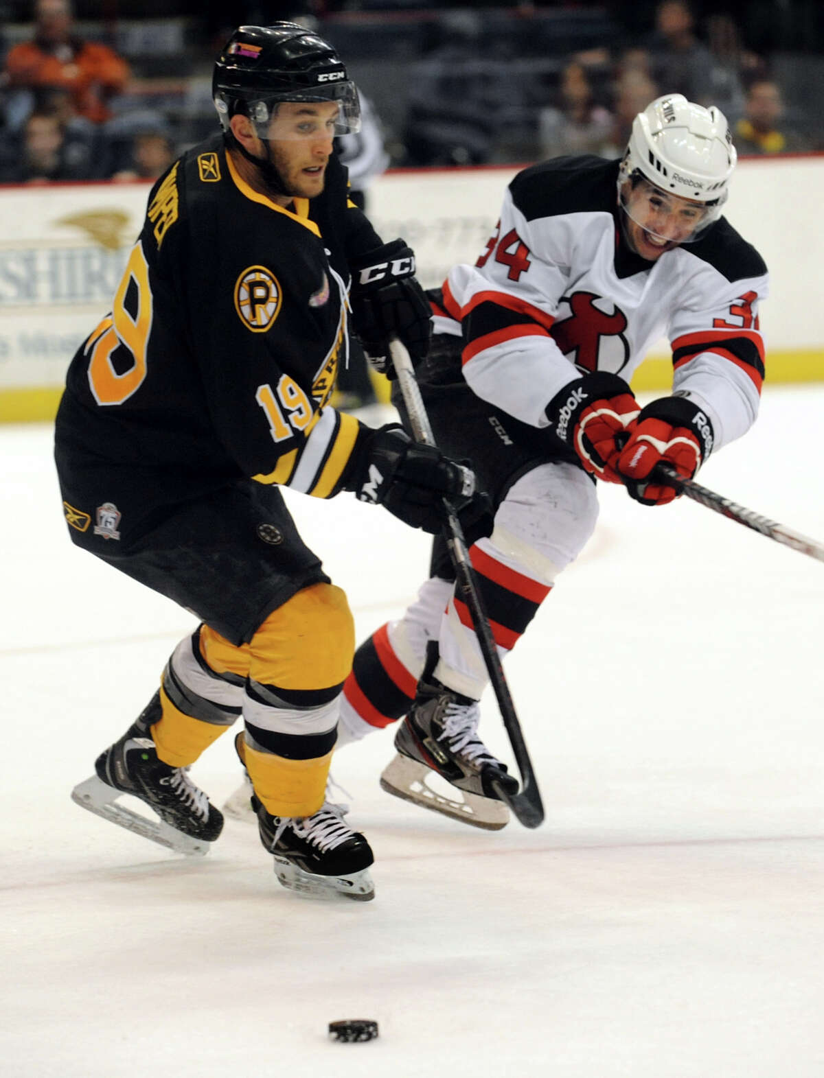 Devils' Phil DeSimone, right, battles Bruins' Carter Camper during their hockey game on Friday, April 5, 2013, at Times Union Center in Albany, N.Y. (Cindy Schultz / Times Union) 18, 12, 5