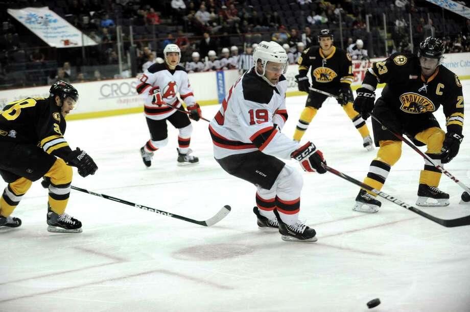 Devils' Mike Sislo, center, chases a loose puck during their hockey game against the Bruins on Friday, April 5, 2013, at Times Union Center in Albany, N.Y. (Cindy Schultz / Times Union)