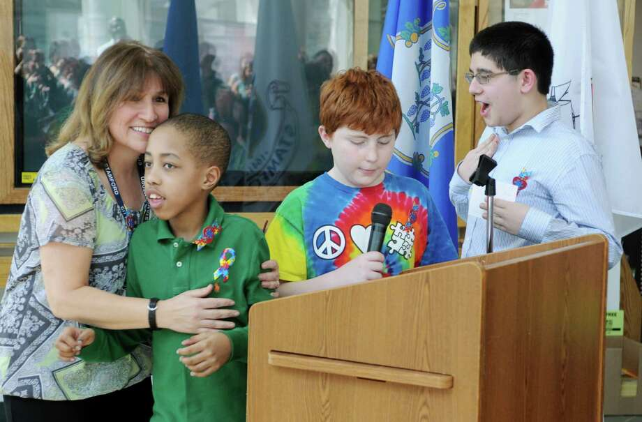 Teacher Barbara Remondino's students from the SE4A Buddies Club speak at Stamford Education 4 Autism Press Conference at the Government Center in Stamford, Conn. on Friday April 5, 2013. Photo: Dru Nadler / Stamford Advocate Freelance