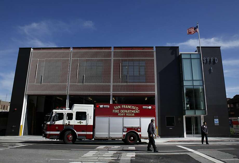 Fire Station 1's upper-floor windows are masked by white steel screens that deflect the sun and offer privacy for firefighters. Photo: Carlos Avila Gonzalez, The Chronicle