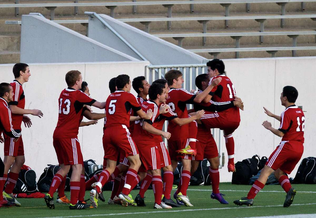 Langham Creek High School celebrates after Fernando Hernandez scored a goal against Cesar Chavez High School during the first half of their soccer matchup at Langham High School, Friday, April 5, 2013, in Houston.
