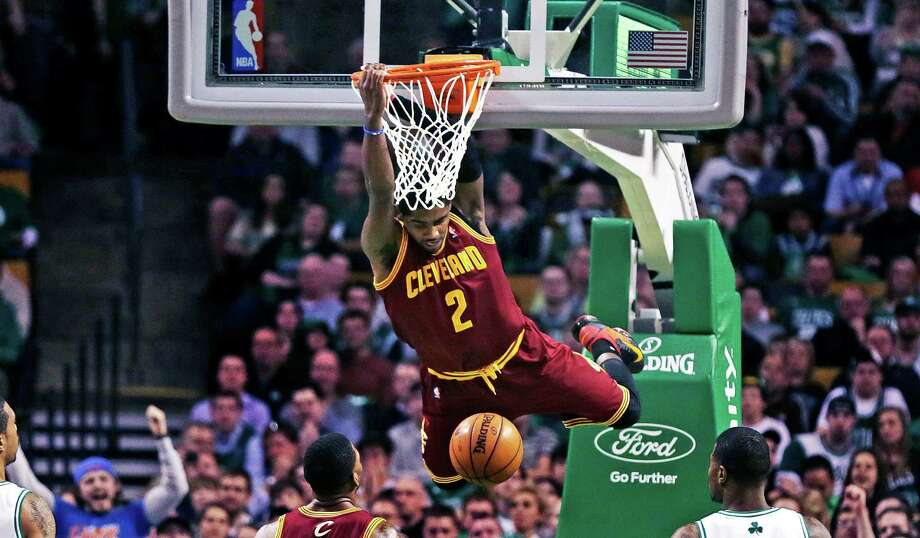Cleveland Cavaliers guard Kyrie Irving (2) dunks during the first quarter of an NBA basketball game against the Boston Celtics in Boston, Friday, April 5, 2013. (AP Photo/Charles Krupa) Photo: Charles Krupa