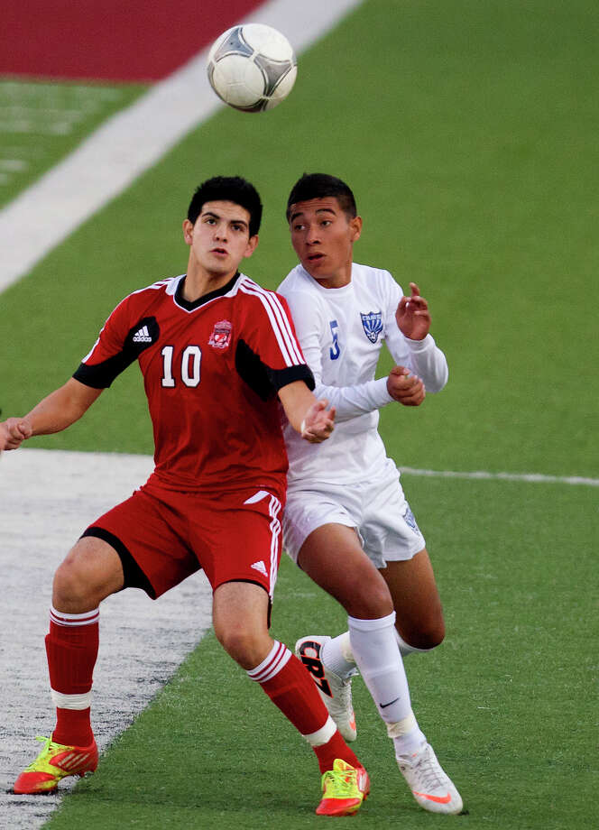 Langham Creek's Fernando Hernandez, left, battles  Chavez's Kenneth Malagon during the first half. Hernandez scored the game-winner in the first half. Photo: Cody Duty, Staff / © 2013 Houston Chronicle