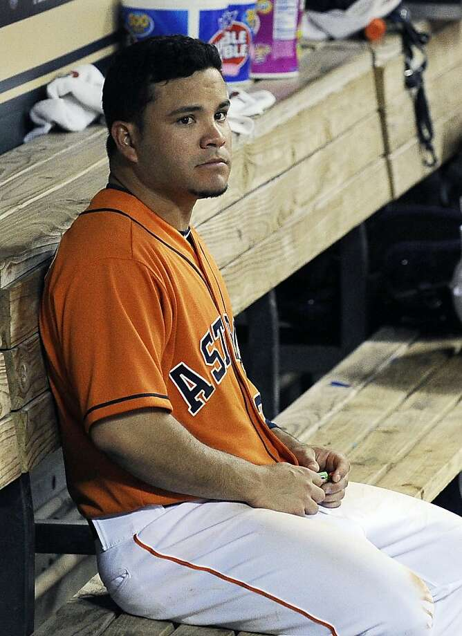 Houston Astros' Jose Altuve sits in the dugout in the fifth inning of a baseball game against the Oakland Athletics Friday, April 5, 2013, in Houston. (AP Photo/Pat Sullivan) Photo: Pat Sullivan, Associated Press
