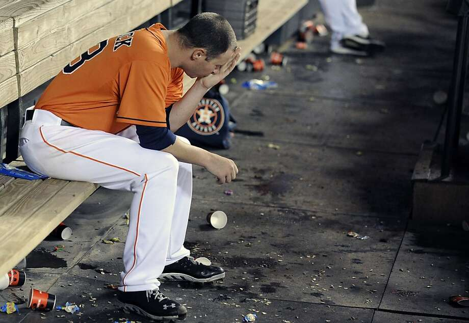 Houston Astros starting pitcher Brad Peacock sits in the dugout after being pulled from the baseball game against the Oakland Athletics in the fifth inning Friday, April 5, 2013, in Houston. (AP Photo/Pat Sullivan) Photo: Pat Sullivan, Associated Press