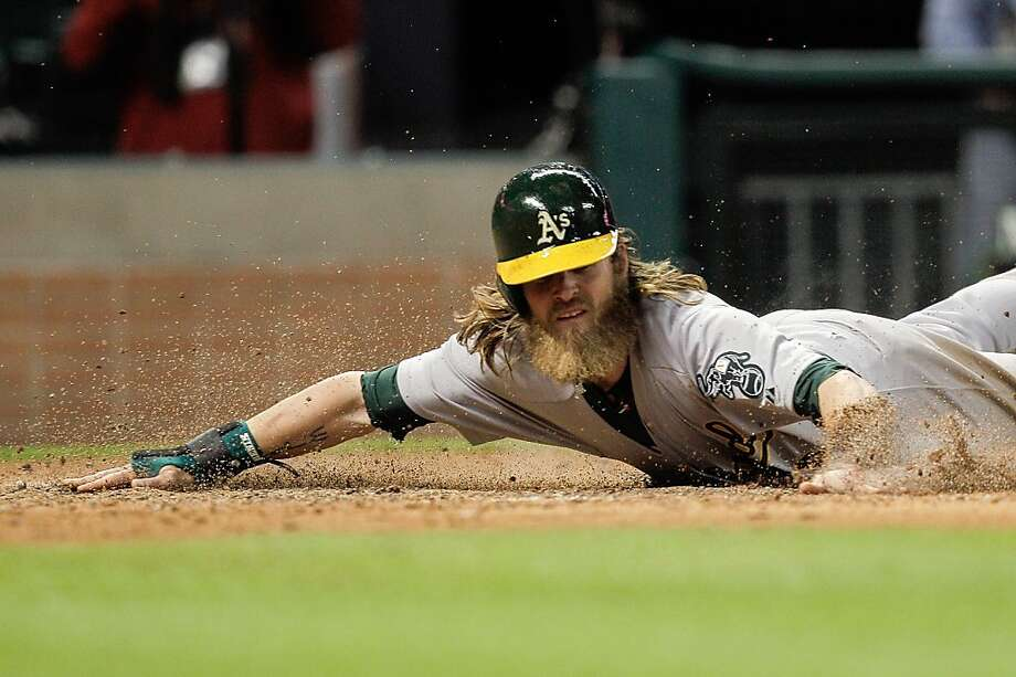HOUSTON, TX - APRIL 05: Josh Reddick #16 of the Oakland Athletics scores on a sacrifice bunt by John Jaso #5 of the Oakland Athletics in the fifth inning against the Houston Astros at Minute Maid Park on April 5, 2013 in Houston, Texas. (Photo by Bob Levey/Getty Images) Photo: Bob Levey, Getty Images