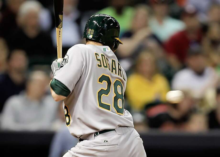 HOUSTON, TX - APRIL 05:  Eric Sogard #28 of the Oakland Athletics is hit in the back in the fifth inning by Xavier Cedeno #63 of the Houston Astros at Minute Maid Park on April 5, 2013 in Houston, Texas.  (Photo by Bob Levey/Getty Images) Photo: Bob Levey, Getty Images