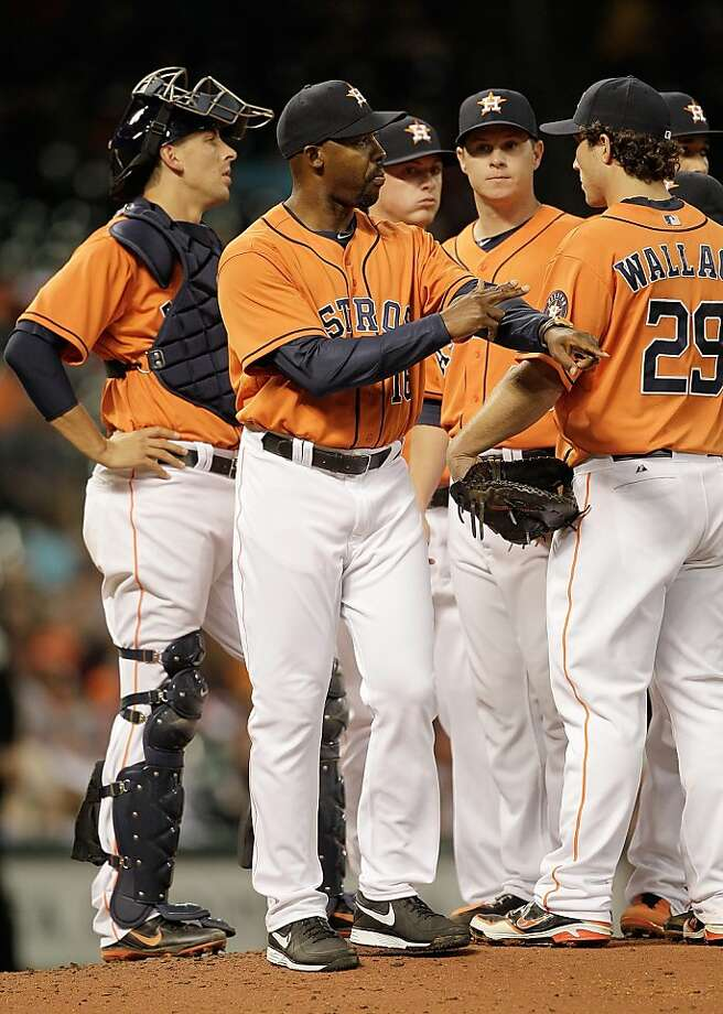 HOUSTON, TX - APRIL 05: Bo Porter #16 of the Houston Astros calls to the bullpen in the fifth inning replacing Brad Peacock at Minute Maid Park on April 5, 2013 in Houston, Texas. (Photo by Bob Levey/Getty Images) Photo: Bob Levey, Getty Images