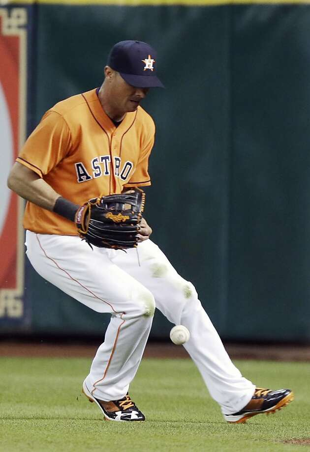 Houston Astros right fielder Rick Ankiel loses the ball, giving Oakland Athletics' Coco Crisp a two-run double in the fifth inning of a baseball game Friday, April 5, 2013, in Houston. (AP Photo/Pat Sullivan) Photo: Pat Sullivan, Associated Press