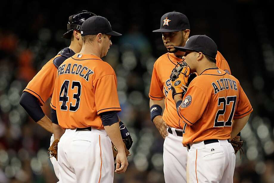 HOUSTON, TX - APRIL 05:  Brad Peacock #43 of the Houston Astros talks on the mound with Jose Altuve #27 of the Houston Astros,Marwin Gonzalez #9 of the Houston Astros and Jason Castro #15 of the Houston Astros against the Oakland Athletics at Minute Maid Park on April 5, 2013 in Houston, Texas.  (Photo by Bob Levey/Getty Images) Photo: Bob Levey, Getty Images