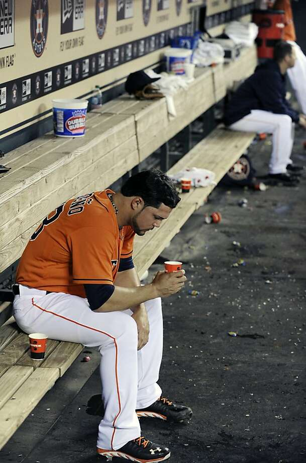 Houston Astros relief pitcher Xavier Cedeno sits alone in the dugout after failing to record an out in a seven-run fifth inning against the Oakland Athletics in a baseball game Friday, April 5, 2013, in Houston. (AP Photo/Pat Sullivan) Photo: Pat Sullivan, Associated Press