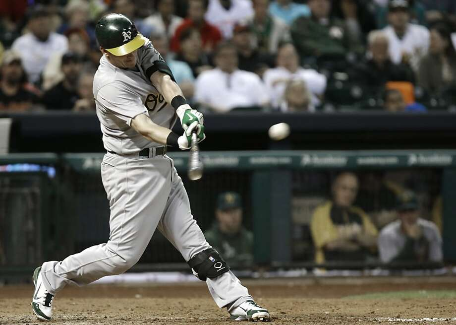 Oakland Athletics' Josh Donaldson connects for a two-run single against the Houston Astros in the fifth inning of a baseball game Friday, April 5, 2013, in Houston. (AP Photo/Pat Sullivan) Photo: Pat Sullivan, Associated Press