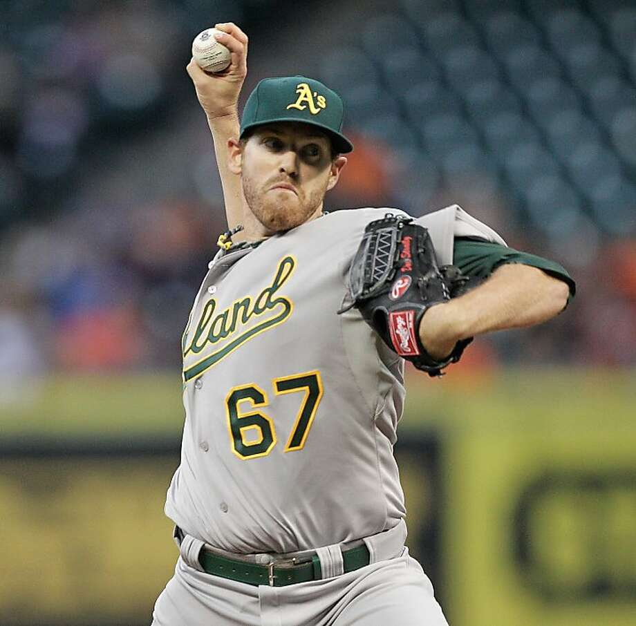 HOUSTON, TX - APRIL 05: Dan Straily #67 of the Oakland Athletics throws against the Houston Astros in the first inning at Minute Maid Park on April 5, 2013 in Houston, Texas. (Photo by Bob Levey/Getty Images) Photo: Bob Levey, Getty Images