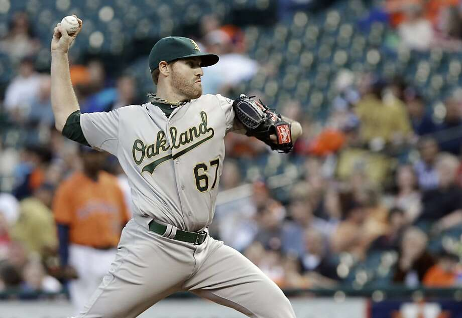 Oakland Athletics' Dan Straily delivers a pitch against the Houston Astros in the first inning of a baseball game Friday, April 5, 2013, in Houston. (AP Photo/Pat Sullivan) Photo: Pat Sullivan, Associated Press