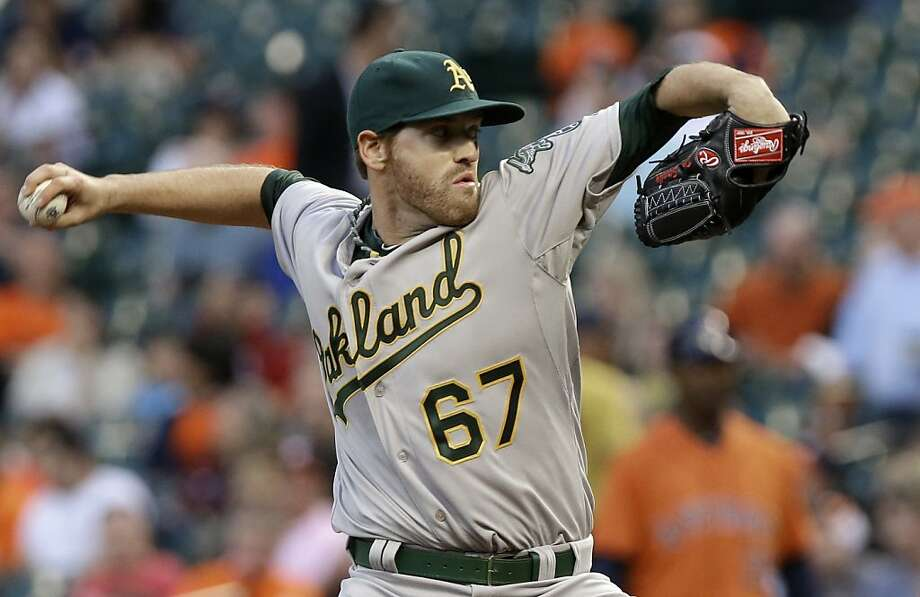 Oakland Athletics pitcher Dan Straily works against the Houston Astros in the first inning of a baseball game Friday, April 5, 2013, in Houston. (AP Photo/Pat Sullivan) Photo: Pat Sullivan, Associated Press