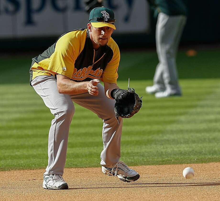 HOUSTON, TX - APRIL 05: Jed Lowrie #8 of the Oakland Athletics takes infield before playing the Houston Astros at Minute Maid Park on April 5, 2013 in Houston, Texas. (Photo by Bob Levey/Getty Images) Photo: Bob Levey, Getty Images