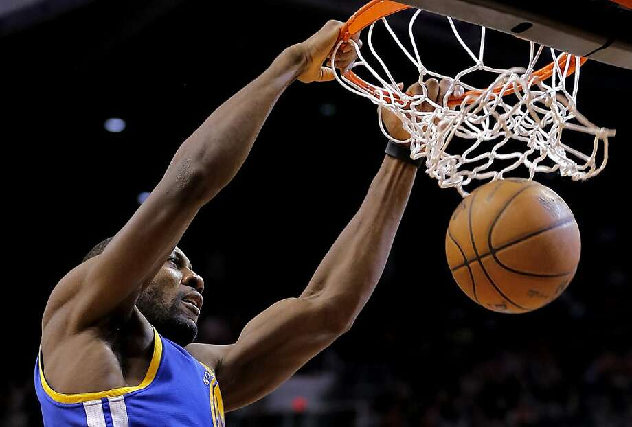 Golden State Warriors' Festus Ezeli, of Nigeria, dunks against the Phoenix Suns during the first half of an NBA basketball game on Friday, April 5, 2013, in Phoenix. (AP Photo/Matt York) Photo: Matt York, Associated Press