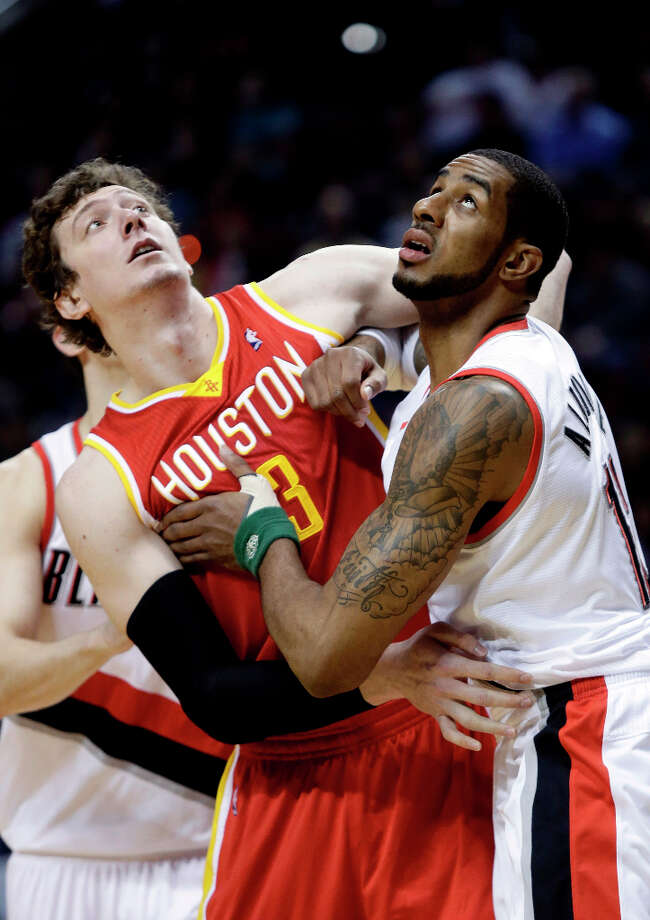 Rockets center Omer Asik and Trail Blazers forward LaMarcus Aldridge battle for position under the basket during the first quarter. Photo: Don Ryan