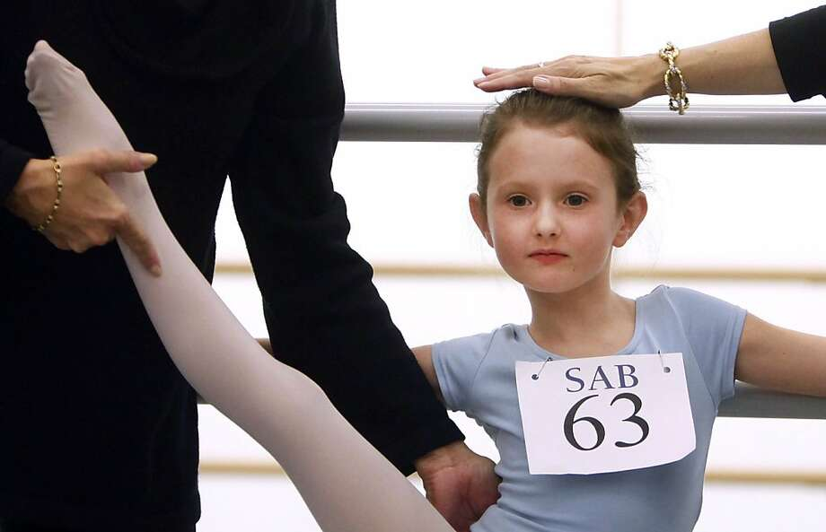 Natacha Ross, 6, of New York, is evaluated during an audition for six-year old ballet hopefuls at the School of American Ballet, Friday, April 5, 2013 in New York. (AP Photo/Jason DeCrow) Photo: Jason DeCrow, Associated Press