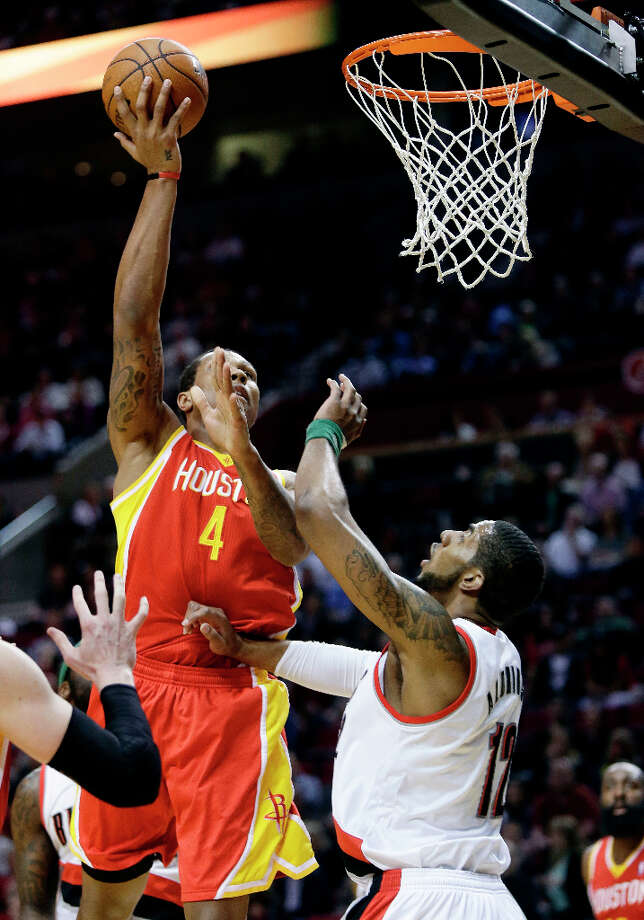 Rockets forward Greg Smith shoots over LaMarcus Aldridge of the Trail Blazers. Photo: Don Ryan