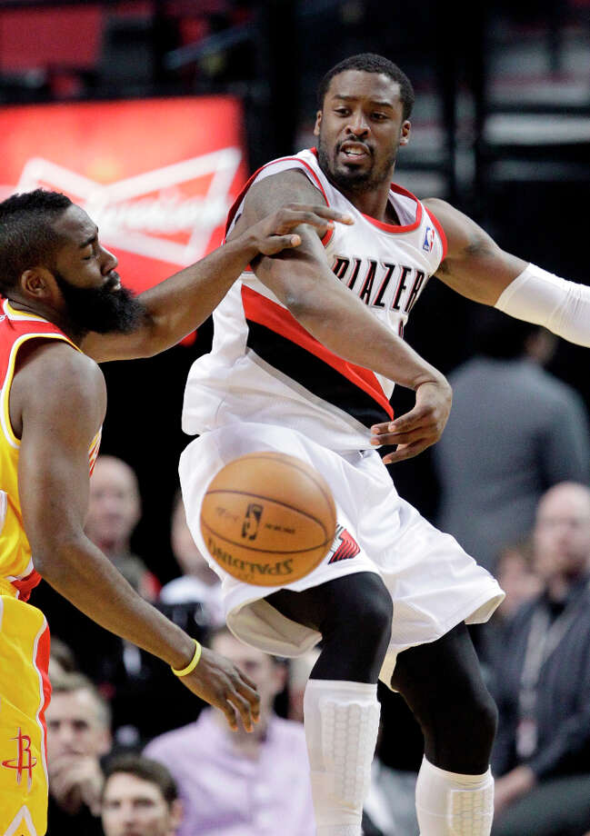 Trail Blazers guard Wesley Matthews passes the ball while being defended by Rockets guard James Harden. Photo: Don Ryan, Associated Press