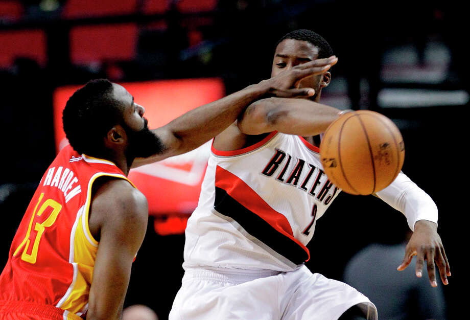 Wesley Matthews of the Trail Blazers is defended by Rockets guard James Harden. Photo: Don Ryan